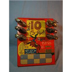 "Vintage punch board 6 cowboys, near mint, 18"" x  14"", rare"