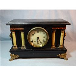 Black mantle clock, 4 column, made in USA, working condition