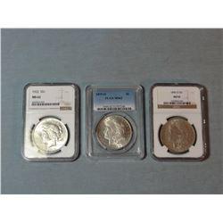 2 Morgan dollars, 1879-O, PCGS MS 62; 1886-O, NGC AU 53;1922 Peace dollar, NGC MS 62