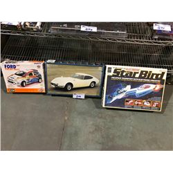 3 IN BOX MODEL TOYS: ELECTRONIC STAR BIRD, 2001 FORD FOCUS RALLY, & TOYOTA 2000GT