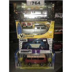 4 NEW IN BOX MODEL CARS: 1981 AIRSTREAN EXCELLA TURBO 280, 1963 BUS PICKUP, 1959 BEETLE, 1973