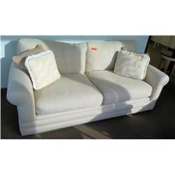 White Upholstered Loveseat w/ Accent Pillows