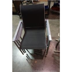 Four metal patio chairs