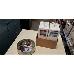 Box of new artificial eye lashes and tin of collectibles