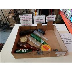 TRAY OF VINTAGE BOTTLES, TOBACCO TIN, RUBBER INSULATOR