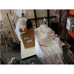 Box of collectible dolls and wedding dress