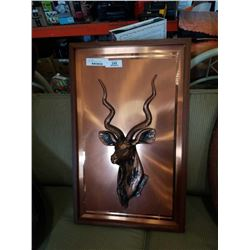 Carved copper antelope wall hanging