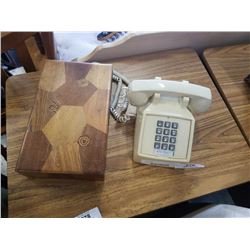 Vintage push botton phone and wood case with nutcracker