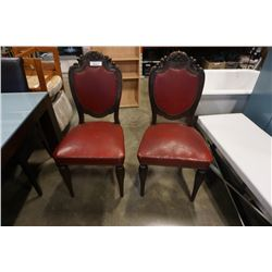 2 antique studded leather chairs