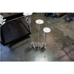 3 white decorative metal candle stands
