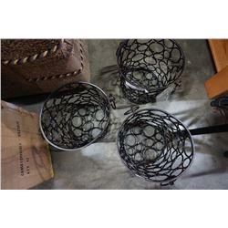 Three decorative metal waste bins
