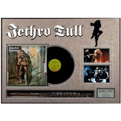 Jethro Tull signed flute and album cover.