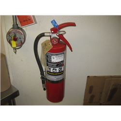 RED FIRE EXTINGUISHER- ALREADY REMOVED FOR PICK UP AT AUCTION