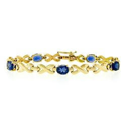 14kt Yellow Gold 6.00 ctw Oval Iolite Puffed X & O Link Tennis Bracelet