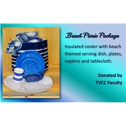 Insulated cooler with beach themed serving dish, plates, napkins and tablecloth.