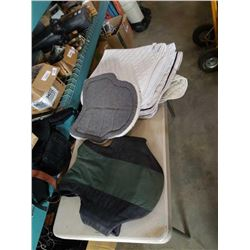 Lot of horse riding saddle pads, and vest