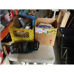Crate and box of caulk, electric drill and kneepads