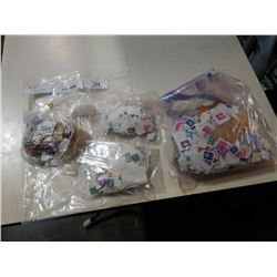 4 BAGS OF MIXED WORLD STAMPS