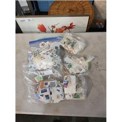 5 BAGS OF MIXED WORLD STAMPS