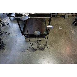 3 black decorative metal candle stands