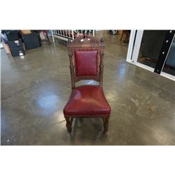 VINTAGE CARVED WOOD CHAIR WITH LEATHER SEAT
