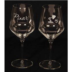 Set of (2) Pixar Wine Glasses.