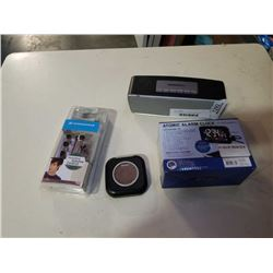 Sennheiser earbuds, bluetooth speaker and digital clocks