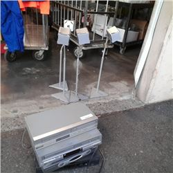 Four stereo components and four Sony speakers with stands