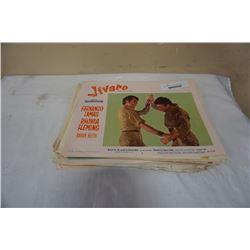 Stack of mid century movie advertisements
