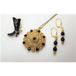 17)  GOLD TONE AND BLACK CRYSTAL