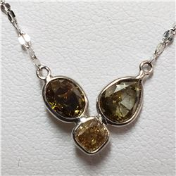 87) 18KT WHITE GOLD FANCY CUT & COLORED BROWN