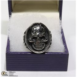 NEW SKULL RING SURROUNDED BY BLACK