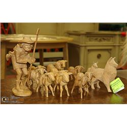 SET OF HAND CARVED WOODEN SHEEP WITH SHEPERD AND
