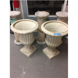 2 plaster planters and 3 cement stands