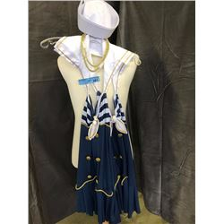 Blue and white sailors costumer with golden necklace and a sailors hat