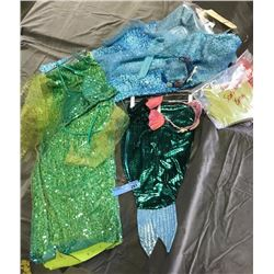multiple mermaid costumes (green and blue)
