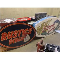 Large lighted Siren song hotel sign and rusty's diner sign