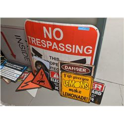A room full of signs, police signs, restaurant signs and misc other signs