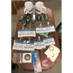 2 cups, multiple room keys with siren song motel tags, multiple ukraine office name badges and misc