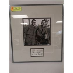 AUTOGRAPHED FRAMED WAYNE AND SHUSTER PICTURE