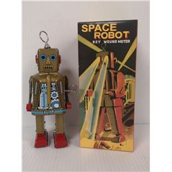 TIN WIND UP SPACE ROBOT WITH BOX