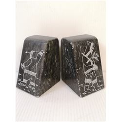PAIR OF SIGNED SOAPSTONE BOOKENDS. ESTATE