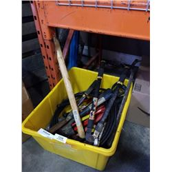 Tote of pruners, sledge hammer and airline