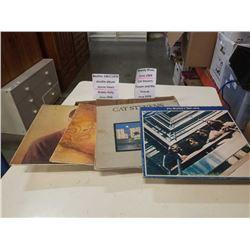 4 records: Beatles, Moody blues, Buddy holly & cat stevens