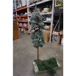 Potters nursury 6 ft tree and lighted garland