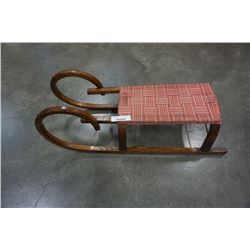 Antique bentwood sled.with metal skates