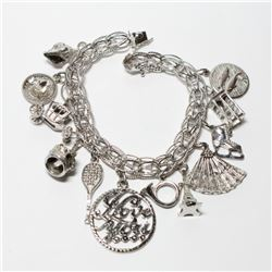 Vintage Sterling Silver Charm Bracelet with 12 Assorted Charms. Weight of 41.89 grams.
