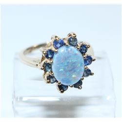 Lady's 10K Yellow Gold Opal & Topaz Ring - Size 6. Total weight of 3.84 grams.