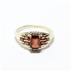 Lady's 10K Yellow Gold Garnet Ring with Diamond Accents - Size 8 1/2. Total weight of 3.28 grams.
