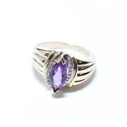 Lady's 10K Yellow Gold Amethyst Ring with Diamond Accents - Size 7.  Total weight of 3.22 grams.